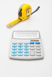 Instruments for measurement and calculating - yellow ruler and calculator Royalty Free Stock Image