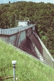 Instruments of measurement strain gauge and topographic level for stability monitoring on a dam. Royalty Free Stock Photos