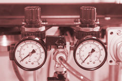Instruments for measuring pressure in red hue Stock Image