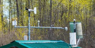 A weather station beside a river bridge in the springtime Royalty Free Stock Photos