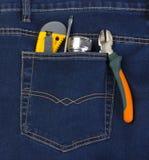 Instrumenty i latarka w twój kieszeniowych cajgach Fotografia Stock