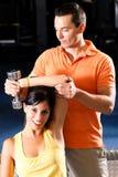 Instrutor pessoal na ginástica Imagem de Stock