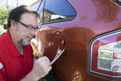 Insuance Adjuster Figuring Damages To Vehicle Stock Images