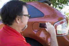 Insuarance Adjuster Taking Photos Royalty Free Stock Photography