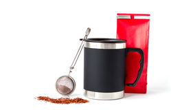 Insulated Cup with Red Paper Bag and Tea Infuser Stock Images