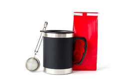 Insulated Cup with Red Paper Bag and Tea Infuser Stock Image
