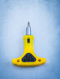 Insulated electric screwdriver on metallic background constructi Stock Photography