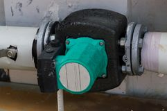 Insulated green circulation pump for glycol circuit of the air handling unit. Insulated circulation pump for glycol circuit of the air handling unit Stock Images