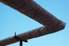 Insulated heating pipes outdoors against the sky Stock Photo