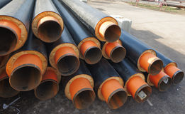 Insulated metal plumbing pipes construction site Royalty Free Stock Image