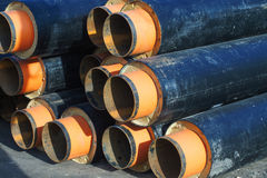 Insulated metal plumbing pipes construction site Royalty Free Stock Images