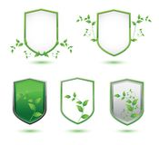 Insulated shield banner with green leaves on a Stock Image