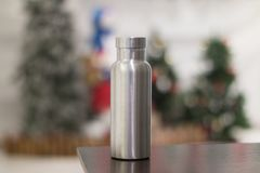 Insulated Stainless Bottle with christmas tree decoration background