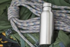 Insulated Stainless Bottle with climbing rope stock images