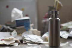 Insulated Stainless Bottle on a dirty office desk stock image