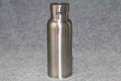 Insulated Stainless Bottle on gray background stock photo