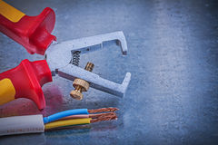 Insulated strippers electrical wires on metallic background dire Stock Image
