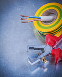 Insulated strippers electricians tape electrical wires on metall Royalty Free Stock Photos