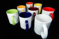 Insulated unprinted cups for sublimation of different shapes, colors and designs designer on a black background isolated. Insulated unprinted cups for Royalty Free Stock Photography