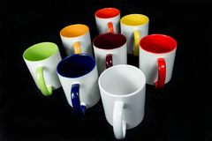 Insulated unprinted cups for sublimation of different shapes, colors and designs designer on a black background isolated. Insulated unprinted cups for Royalty Free Stock Image