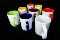 Insulated unprinted cups for sublimation of different shapes, colors and designs designer on a black background isolated. Insulated unprinted cups for Stock Photography