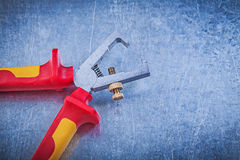 Insulated wire strippers on metallic background electricity conc Royalty Free Stock Photography