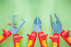 Insulated wire strippers pliers nippers on green background elec Stock Images