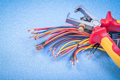 Insulated wire strippers set of electric cables on blue backgrou Stock Photo