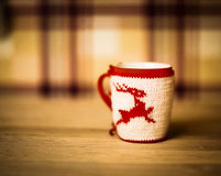 Insulated wool cloth mug with embroidered deer Stock Photography