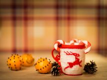 Insulated wool cloth mug with embroidered deer Royalty Free Stock Photos