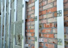 Insulating Construction. House brick wall insulation for energy saving. Renovation and insulation residential house. Insulation house Stock Image