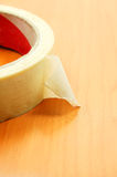 Insulating tape. On wood texture background Stock Image