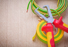 Insulating tape electric cable insulated wire strippers on woode Stock Photography