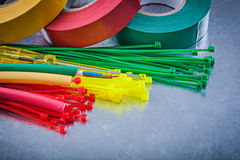 Insulating tapes plastic cable ties electric wires on metallic b Stock Photo