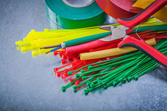 Insulating tapes plastic cable ties electric wires nippers Royalty Free Stock Image