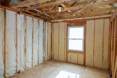 Insulation of attic with fiberglass cold barrier and insulation material. Thermal insulation attic royalty free stock image