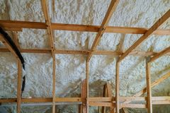 Insulation of attic with foam polyurea insulation cold barrier and insulation material. Insulation of attic with foam insulation cold barrier and insulation stock images