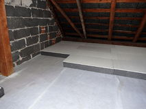 Insulation of the attic - polystyrene stock images