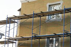 Insulation of the building facade. energy-saving technologies in construction. royalty free stock images
