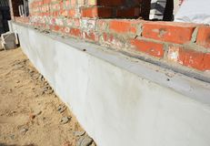Insulation house wall foundation with styrofoam insulation sheets for home energy saving and bitumen membrane for foundation wate royalty free stock image