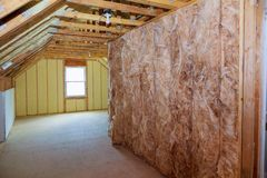 Wall of an apartment building, covered with insulation foam before. Insulation insulation of a new building with foam wall of an apartment building, covered with royalty free stock photo