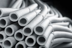 Insulation for pipes. On black Stock Photos