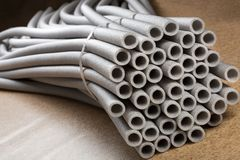 Insulation for pipes. Lots of thermo pipes for tubes Royalty Free Stock Photos