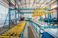 Insulation sandwich panel production line. Machine tools, roller conveyor in workshop.  stock image