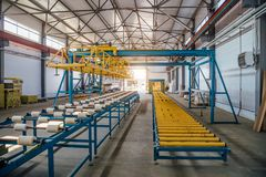 Insulation sandwich panel production line. Machine tools, roller conveyor in workshop.  stock images