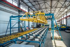 Insulation sandwich panel production line. Machine tools, roller conveyor in workshop.  royalty free stock photography