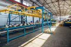 Insulation sandwich panel production line. Machine tools, roller conveyor in workshop.  royalty free stock photo