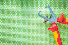 Insulation strippers on green background electricity concept Royalty Free Stock Photography