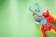 Insulation strippers sharp nippers on green background electrici Royalty Free Stock Image