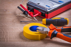 Insulation tape nippers screwdriver multimeter On Stock Photography